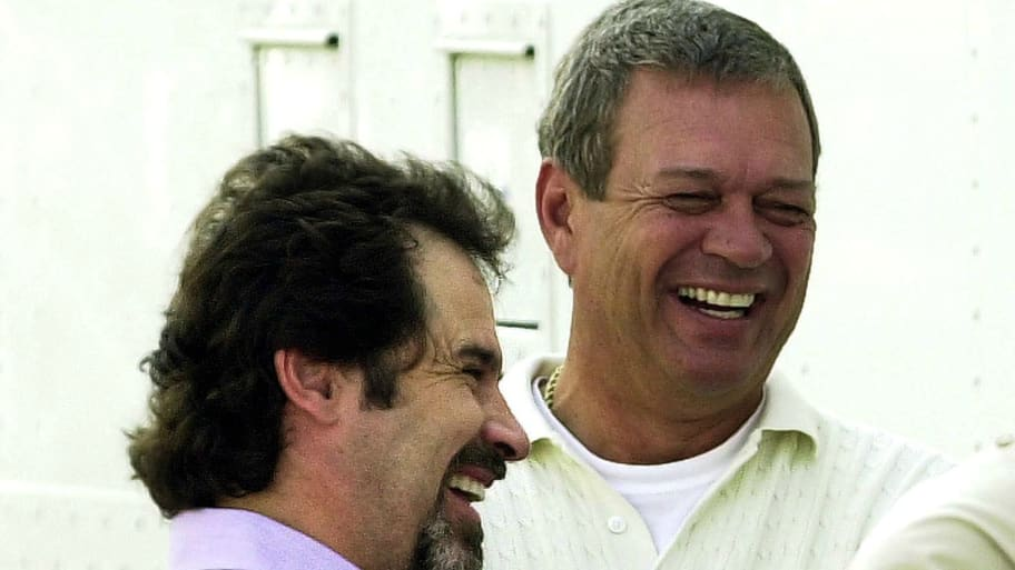 Dennis Miller (L) talks with Monday Night Football producer Don Ohlmeyer