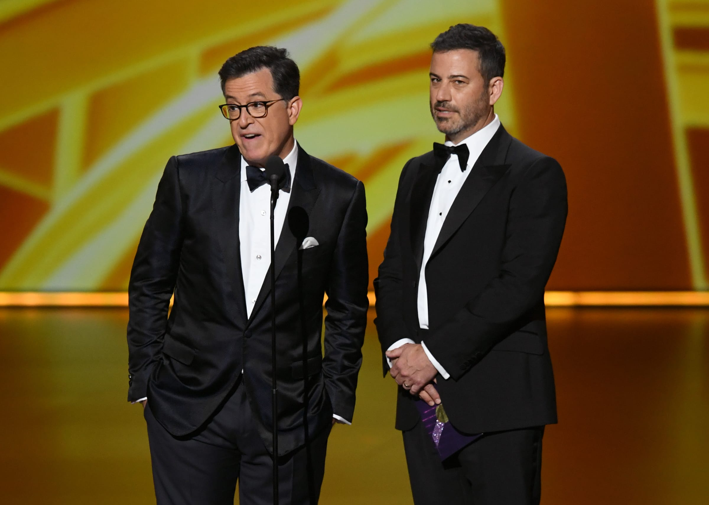 Stephen Colbert and Jimmy Kimmel speak onstage during the 71st Emmy Awards at Microsoft Theater on September 22, 2019, in Los Angeles, California. Kevin Winter/Getty