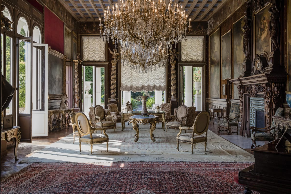 'Armchairs and tables stand beneath chandeliers as 19th century portraits in ornate frames adorn the walls of a sitting room inside the Villa Les Cedres, a 187-year-old, 18,000-square-foot, 14-bedroom mansion set on 35 acres, in Saint-Jean-Cap-Ferrat, France, on Tuesday, Sept. 26, 2017.' Bloomberg/Getty