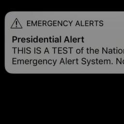 QAnoners Cheer Trump's Text Alert Test, See It as a Step Toward